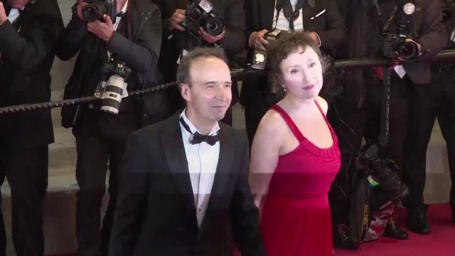 Roberto Benigni and his wife actress and producer Nicoletta Braschi walk the red carpet at the Cannes premiere of Dogman running for the Palme d'Or