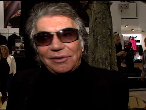 roberto cavalli on being at the handm store seeing the fans/customers and his favorite piece in the collection at the roberto cavalli for hm launch... - roberto cavalli stock videos and b-roll footage