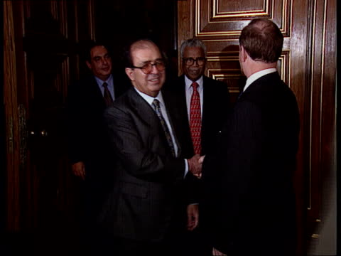 London Downing Street Robin Cook MP walking along street and into No10 INT Cook into room and greeted by Tony Blair PM as they sit down for meeting...
