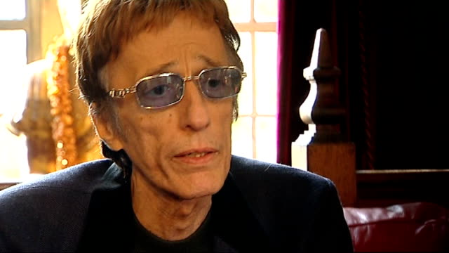 robin gibb makes record in aid of 2011 poppy appeal: performance and interviews; robin gibb interview sot - on why he is supporting the poppy appeal... - the bee gees bildbanksvideor och videomaterial från bakom kulisserna
