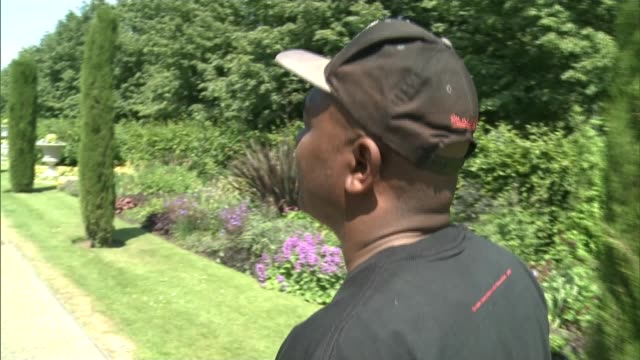 Robin named as Britain's favourite bird ENGLAND London EXT David Lindo putting on shoes and cap and standing posing with interview overlaid SOT On...