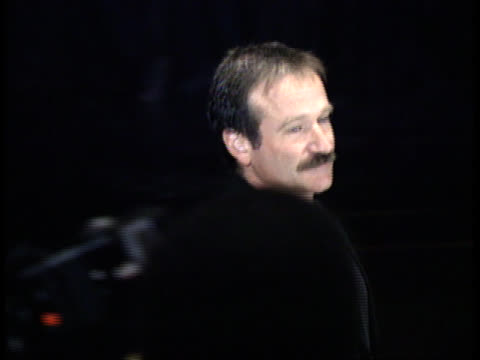 robin williams jokes and poses on the red carpet - friars roast 1993 stock videos and b-roll footage