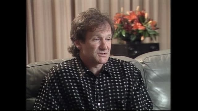 vídeos de stock e filmes b-roll de robin williams speaking about his attitude towards politics and human rights in 1996 during interview with host ewart barnsley - robin williams ator