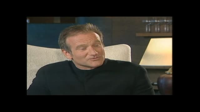 vídeos de stock e filmes b-roll de robin williams speaking about his energy and balancing family life in 1999 during interview with host paul holmes - robin williams ator