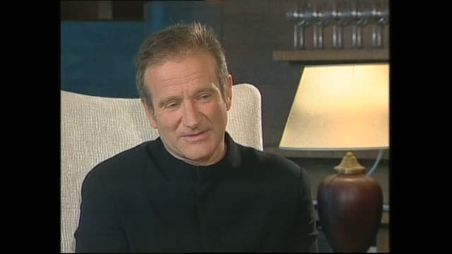 vídeos de stock e filmes b-roll de robin williams speaking about the costume he wore during filming of bicentennial man movie in 1999 during interview with host paul holmes - robin williams ator