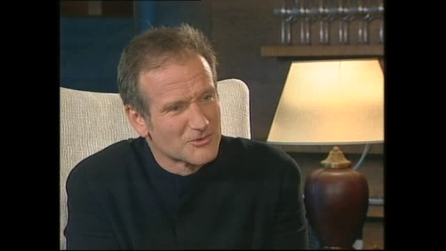 vídeos de stock e filmes b-roll de robin williams speaking about working with sam neill on bicentennial man movie in 1999 during interview with host paul holmes - robin williams ator