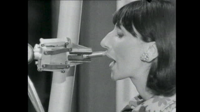 robot arm applies lipstick to woman - black and white stock videos & royalty-free footage