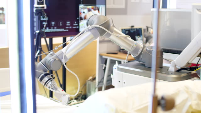 stockvideo's en b-roll-footage met robot arm machine voor echografie - afstandsbediening