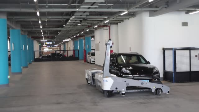 ray robot automatic parking equipment carries a car at beijing daxing international airport parking building on october 19 2019 in beijing china... - parking stock videos & royalty-free footage