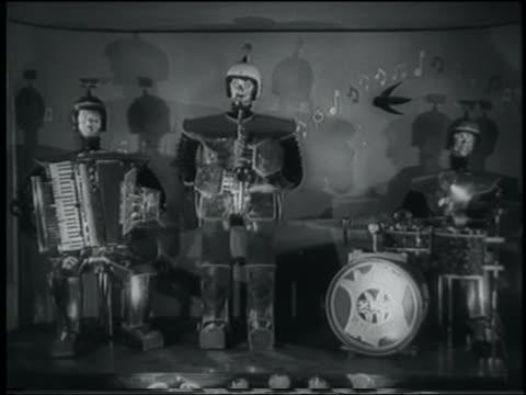 vídeos de stock e filmes b-roll de b/w 1958 robot band playing accordion, saxophone + drums - acordeão instrumento