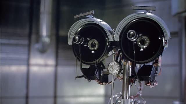 cu robot closing eyes - robot video stock e b–roll