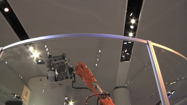 ms tu td robot displays ford engines at the 2010 detroit auto show / detroit, michigan, usa - trade show stock videos and b-roll footage