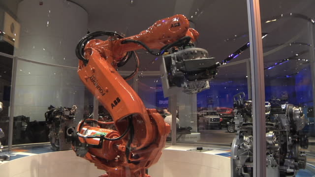 ms tu td pan robot displays ford engines at the 2010 detroit auto show / detroit, michigan, usa - trade show stock videos and b-roll footage