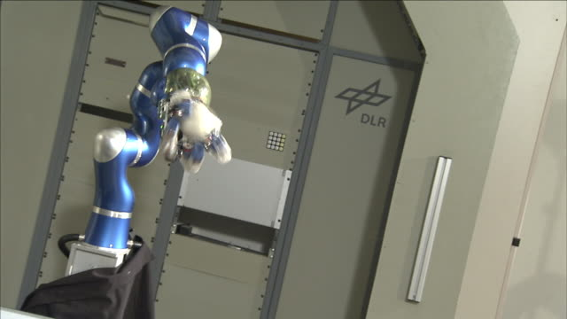 a robot hand catches a baseball in a laboratory. - ball stock videos & royalty-free footage