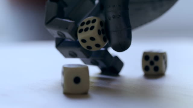 robot hand rolling dice - man made stock videos & royalty-free footage