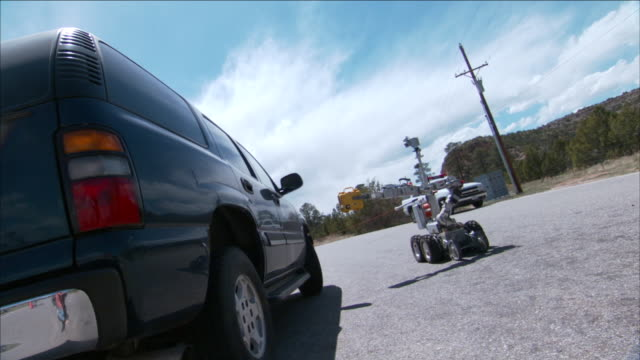 a robot inspects a car as it slowly travels past. - land vehicle stock videos & royalty-free footage