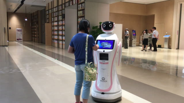 robot librarian is working in tianjin chinasingapore ecocity library tianjin chinasingapore ecocity library is a library equipped with ai technology... - librarian stock videos & royalty-free footage