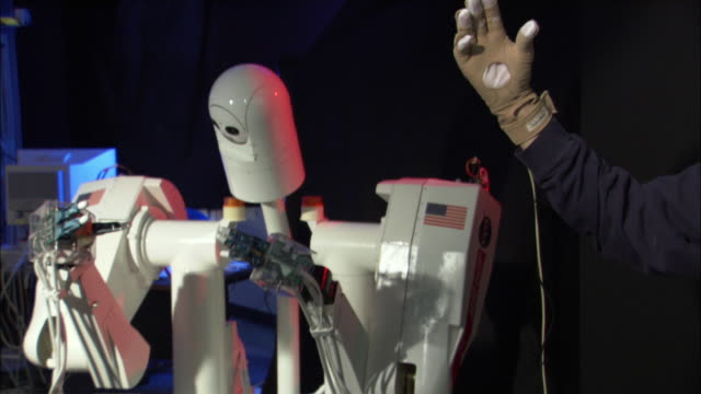 CU ZO NASA Robot moving hands being controlled by human wearing virtual reality glove, Houston, Texas, USA