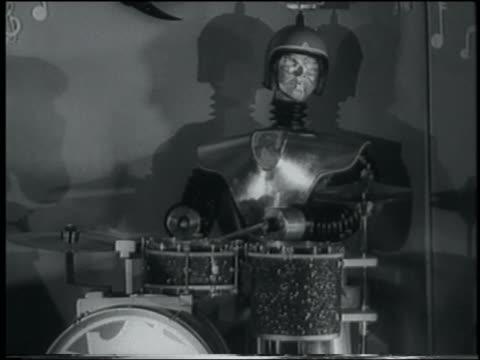 B/W 1958 robot playing drums