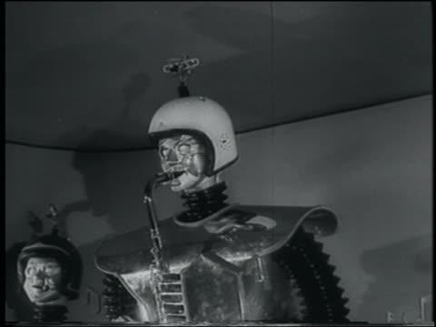 B/W 1958 robot playing saxophone