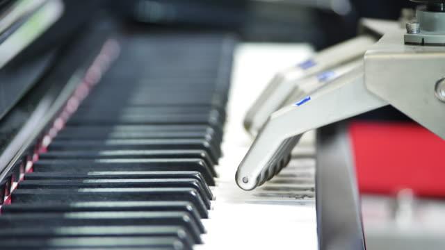 robot playing with piano - piano stock videos & royalty-free footage