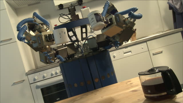 a robot serves coffee in a kitchen. - domestic kitchen video stock e b–roll