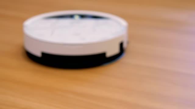 robot vacuum cleaner  : wood laminate flooring - appliance stock videos & royalty-free footage