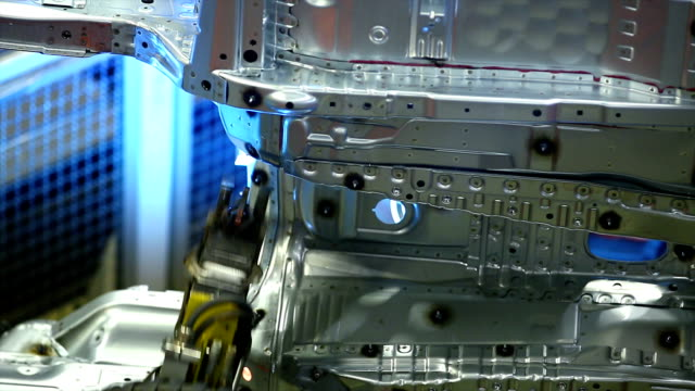 robot welding on car body close-up - automobile industry stock videos & royalty-free footage