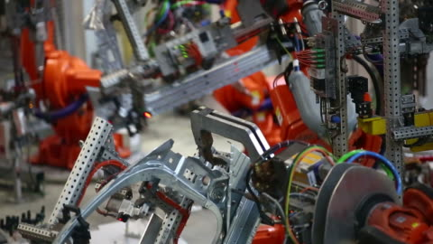 robot welding on car body medium shot - industri bildbanksvideor och videomaterial från bakom kulisserna