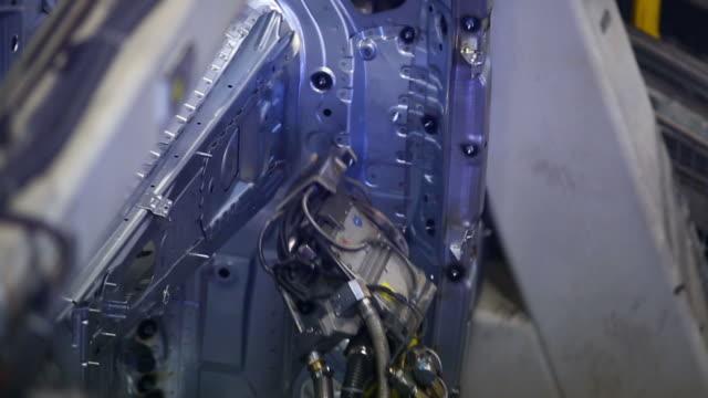 hd robot welding on car body - aluminum sheet stock videos and b-roll footage