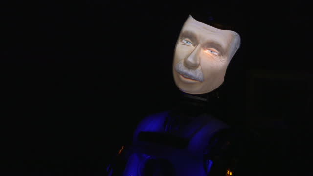 robothespian robot actor, in the guise of a mature man, starts 'singing' after its 'eyes' turn from brown to blue during rehearsals for a play, uk. - television show stock videos & royalty-free footage