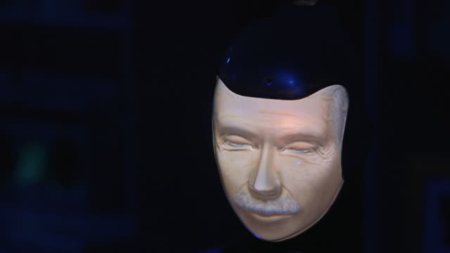 a robothespian robot actor taking part in a play about dementia 'powers down' becoming static and turning blue uk rushes taken from bbccom/culture... - robot and human face stock videos & royalty-free footage