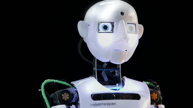 robothespian robot turning head and blinking - silver coloured stock videos & royalty-free footage