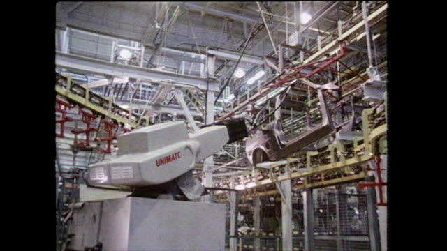 robotic arm lifts car door on uk production line; 1986 - brightly lit stock videos & royalty-free footage