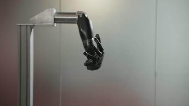 Robotic arm moves fingers