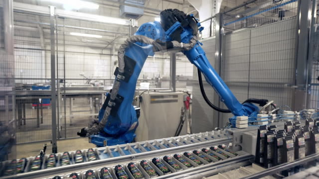 a robotic arm packs tubes onto plastic trays - factory stock videos & royalty-free footage