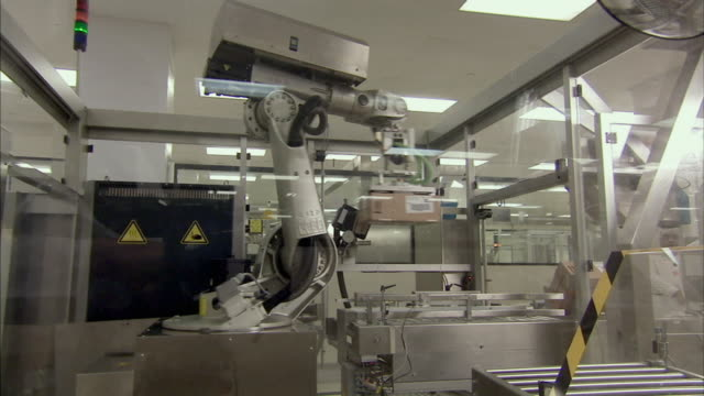 ms td robotic arm stacking boxes for packaging, boxmeer, netherlands - boxmeer stock videos & royalty-free footage
