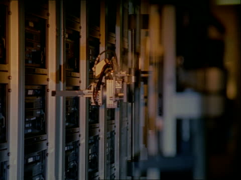 ms, selective focus, robotic arm taking tape from video tape player - videocassette stock videos & royalty-free footage