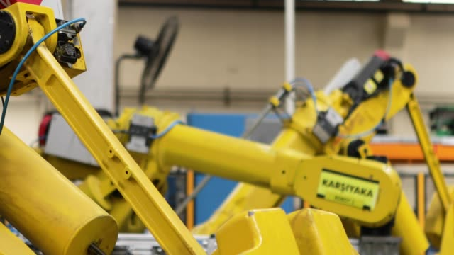 robotic arms in a factory - manufacturing stock videos & royalty-free footage
