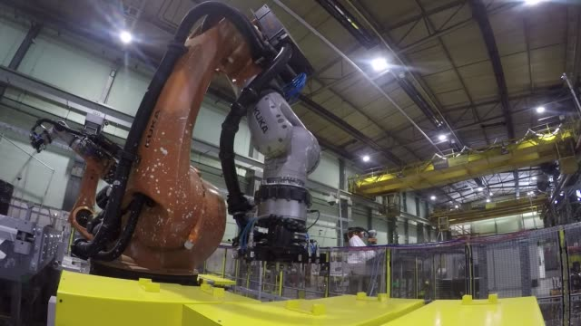 robotic arms, manufactured by kuka ag, perform mock operations on handling contaminated barrels of sludge and debris at the national nuclear... - radiation stock videos & royalty-free footage