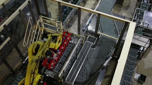 robotic arms package bottles of grolsch kornuit premium pilsner beer inside the grolsch brewery operated by sabmiller plc in enschede netherlands on... - pilsner stock videos & royalty-free footage