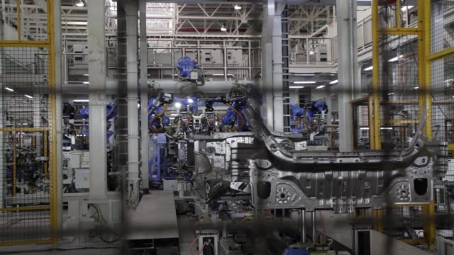 Robotic arms weld parts of Honda Civic vehicles at the Honda Motor Co assembly plant in Prachinburi Prachinburi Province Thailand on Thursday May 12...