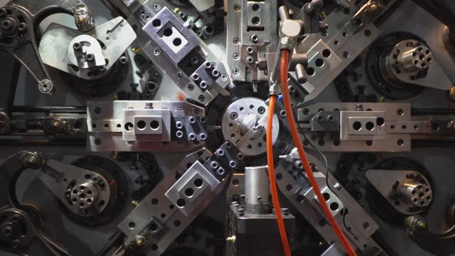 robotic automatic machine are making springs, cnc coil sporing making machine, operator making automotive spring part process in factory. - spiral stock videos & royalty-free footage