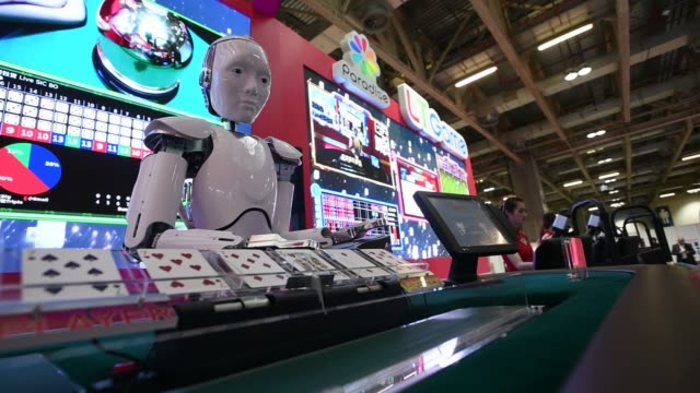 A robotic dealer manufactured by LT Game Ltd a subsidiary of Paradise Entertainment Ltd stands on display during the Macau Gaming Show in Macau China...