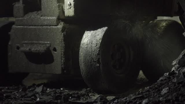 cu of robotic digging machine moving in mine tunnel - mining stock videos & royalty-free footage