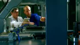 Robotic engineers checking machinery in warehouse 4k