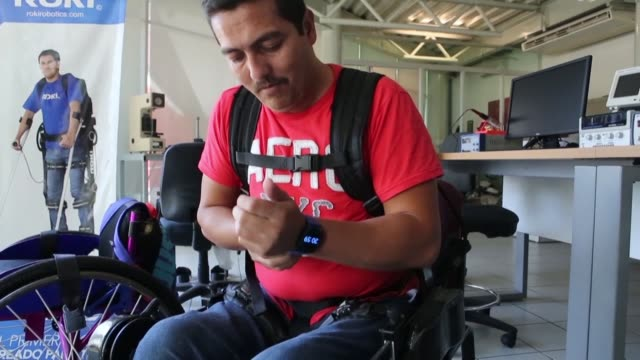 a robotic exoskeleton created in mexico helps people without mobility in their legs to walk as is the case of jesus who has been in a wheelchair... - exoskeleton stock videos & royalty-free footage