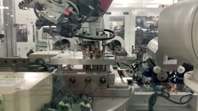 ロボット産業工学設備ロボットアーム作業 - 梱包機点の映像素材/bロール