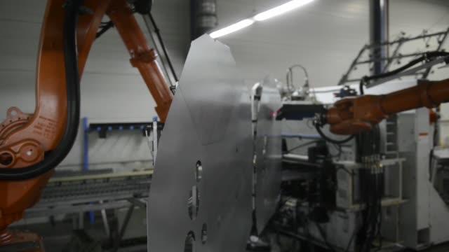 A robotic machine produces laser welded steel blanks inside the Voestalpine AG steel plant in Linz Austria on Wednesday Dec 2 2015