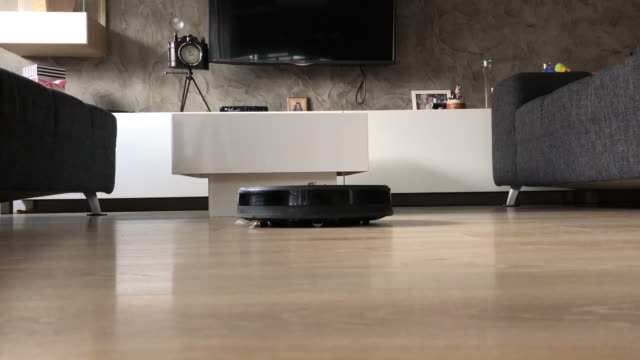 robotic vacuum cleaner dusting - chores stock videos & royalty-free footage